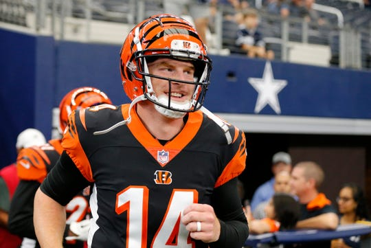 Cincinnati Bengals quarterback Andy Dalton (14) runs to the field during pregame warmups before the NFL Preseason Week Two game between the Dallas Cowboys and the Cincinnati Bengals at AT&T Stadium in Arlington, Texas, on Saturday, Aug. 18, 2018.