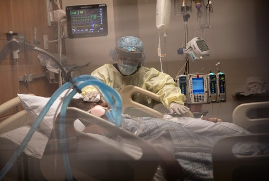 A nurse with a COVID-19 patient on a ventilator at Connecticut's Stamford Hospital on April 24.