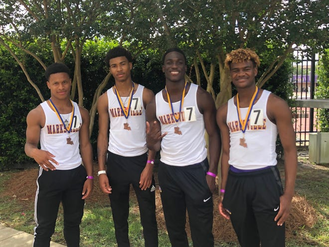 Marksville's 4x100 relay team of Travonta Antoine (left), E.J. Williams, Daniel Miller and Kameron Williams pose after taking third at the LHSAA state meet last year. Antoine, Williams, Miller and Triston Dunbar were hoping to improve from that mark this year.