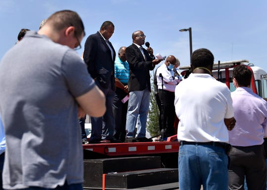 Rich Brown of Grace Point Church sermonizes from the flatbed of a tow truck during the National Day of Prayer service at the Abilene Police Department's parking lot.