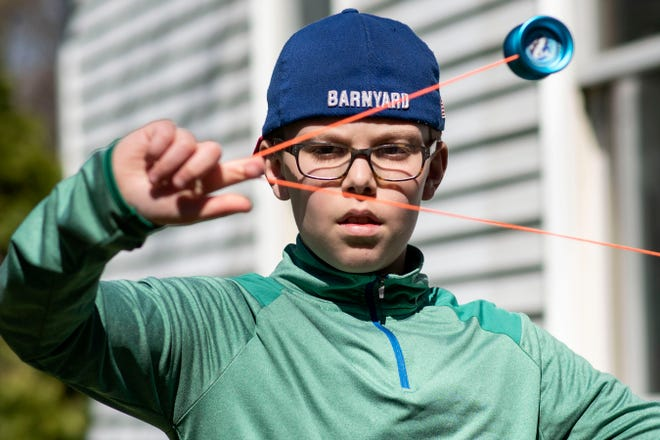 Julian Fowler, 11, performs yo-yo tricks on Thursday, May 7, 2020 in his yard in Battle Creek, Mich. Fowler is entering a virtual talent show that is taking place during the coronavirus pandemic.