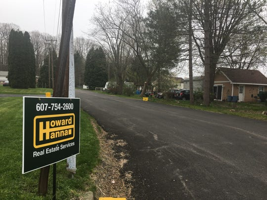 A Howard Hanna Real Estate Services sign displayed on a residential street in West Corners, Broome County. Realtors expect more opportunities as New York State reopens.