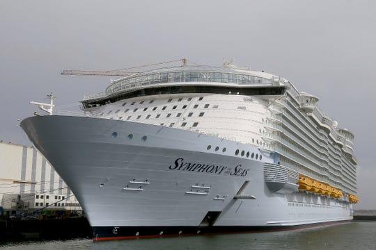 FILE- In this March 23, 2018 file photo, the Symphony of the Seas docks at Saint Nazaire port, France. The family of Pujiyoko, a cruise crew member who died after testing positive for COVID-19, has filed a lawsuit against Royal Caribbean Cruises saying the company failed to protect its employees. Pujiyoko worked in housekeeping on the Symphony of the Seas ship. (AP Photo/David Vincent, File)