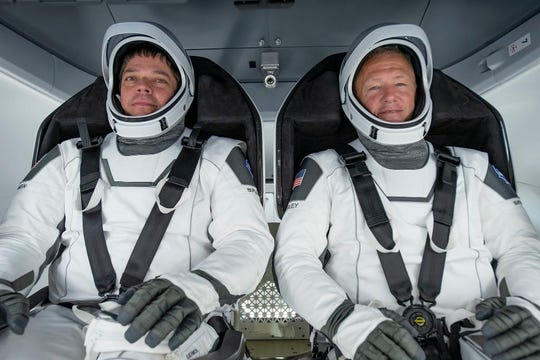 Robert Behnken, left, and Doug Hurley will be the first NASA astronauts to fly a commercial spacecraft when they launch on SpaceX's Crew Dragon capsule from Kennedy Space Center pad 39A. It will mark the first time astronauts launch from U.S. soil since the shuttle program retired in 2011.