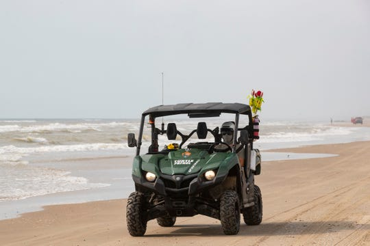 A Biological Science Technician drives a utility task vehicle along Padre Island National Seashore's South Beach as they look for nesting sea turtles on Wednesday, May 6, 2020.
