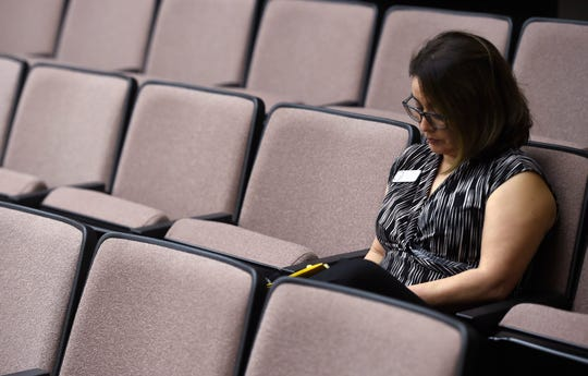 Annette Rodriguez writes notes during the daily press conference about the coronavirus, Wednesday, May 6, 2020, at City Hall. Rodriguez discussed a healthcare worker testing positive as well as the STX meat plant.