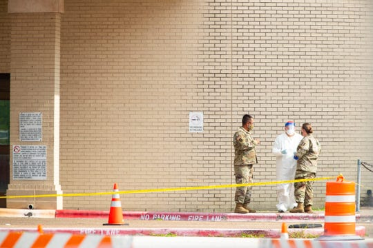 The Texas Army National Guard conduct COVID-19 testing at the Corpus Christi's drive-thru testing center at the old Christus Spohn Memorial Hospital parking lot on Thursday, May 7, 2020.
