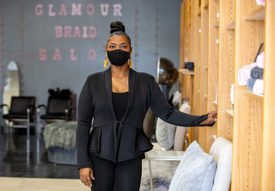 Alethia S. Williams, owner of the Glamour Braid Salon in the Glenway Crossing Shopping Center, said she has been closed since March 18 due to COVID-19, but has been sanitizing her salon to reopen on May 15. Williams said she will close her waiting area and customers will be given a pager to notify them when they can come inside.  Photo shot Thursday, May 7, 2020,