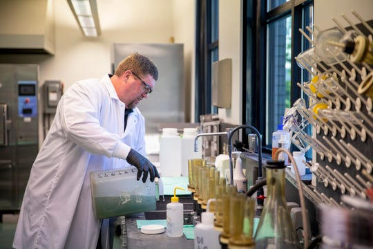 Ralph Rabish, a Metropolitan Sewer District of Greater Cincinnati lab tech, pours a sample of raw sewage that will be sent to the EPA from the Mill Creek Wastewater Treatment Plant in Lower Price Hill on Thursday, May 7, 2020. Part of the sample will be sent to the EPA for a pilot study to track infection trends.