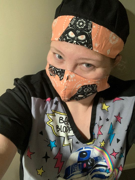 APSU nursing student Sarah Sullivan, wearing a face mask, in New York on May 3, 2020.