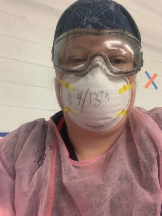APSU nursing student Sarah Sullivan, wearing a face mask and protective gear, working in a level one trauma center in New York on April 13, 2020.