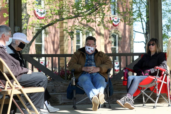 Pastor Larry Massie of Solidrock Foursquare Church in Coshocton leads a small group in prayer outside the Coshocton County Courthouse on Thursday, the National Day of Prayer.