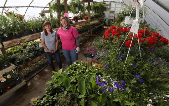 Debbie Gaumer , left, and Kristy Leindecker own and operate The Garden Patch Greenhouse on County Road 10 near Coshocton. The gardening center offers vegetables, annuals and perennials.