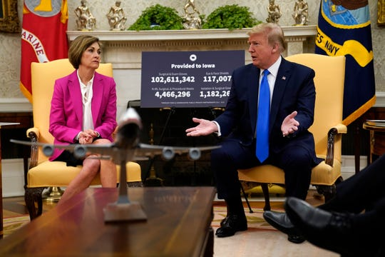 President Donald Trump speaks during a meeting with Gov. Kim Reynolds, R-Iowa, in the Oval Office of the White House, Wednesday, May 6, 2020, in Washington.