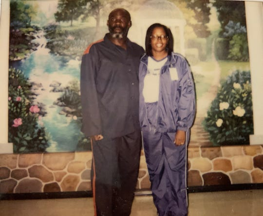 Debra Matthews is pictured with her brother John Thompson during a visit in prison in 2014. Thompson died May 4 of COVID-19.