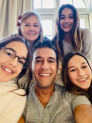 Dr. Sanjay Gupta does most of his television work on CNN from his basement, which allows him to spend more time with his wife and three daughters.