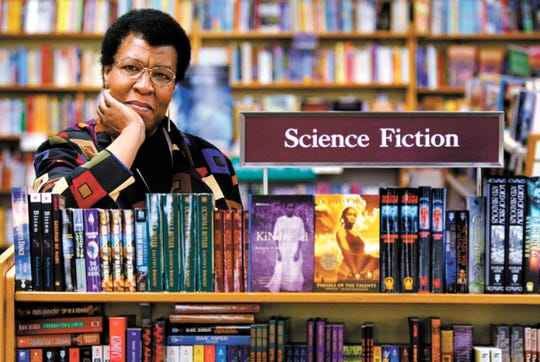 Author Octavia Butler near some of her novels at University Book Store in Seattle, Wash. in 2004.