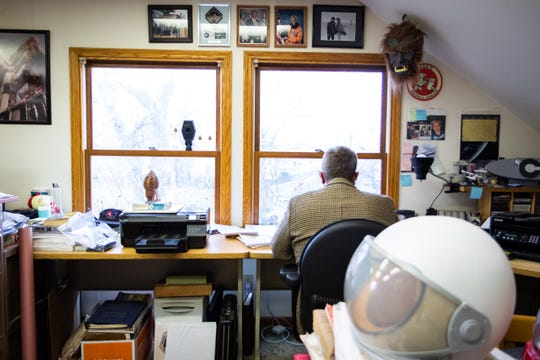 Glen Swanson, former chief historian at NASA's Johnson Space Center, works in his home office above his garage in Grand Rapids.