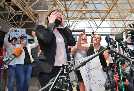 Salon owner Shelley Luther reacts as supporters chant for her after she was released from jail in Dallas, Thursday, May 7, 2020. Luther was jailed for refusing to keep her business closed amid concerns of the spread of COVID-19.