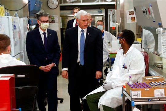 Vice President Mike Pence visits the molecular testing lab at Mayo Clinic Tuesday, April 28, 2020, in Rochester, Minn. He didn't wear a mask.