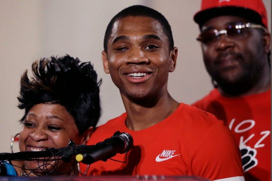 In this June 9, 2016, file photo, Davontae Sanford stands with his mother, Taminko Sanford, and addresses the media during a news conference in Detroit, a day after being released from prison.