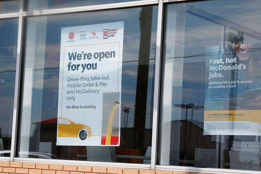 A sign in the window at the McDonald's restaurant states no dine-in seating Thursday, May 7, 2020, in Oklahoma City.