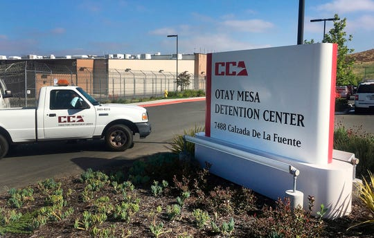 FILE - In this June 9, 2017, file photo, a vehicle drives into the Otay Mesa Detention Center in San Diego. Authorities say a 57-year-old person in immigration custody has died from complications related to the coronavirus, marking the first reported death from the virus among about 30,000 people in U.S. immigration custody.