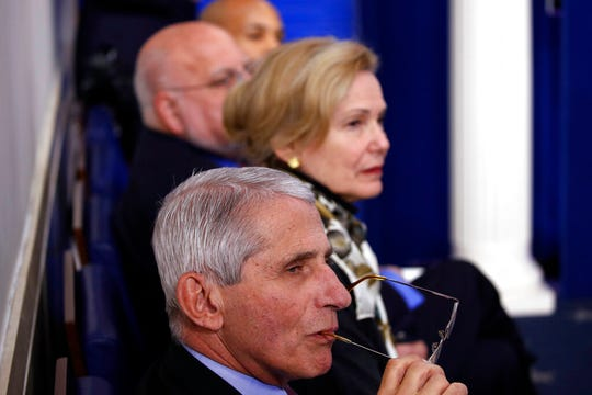 From front, Dr. Anthony Fauci, director of the National Institute of Allergy and Infectious Diseases,, Dr. Deborah Birx, White House coronavirus response coordinator,, Dr. Robert Redfield, director of the Centers for Disease Control and Prevention, and U.S. Surgeon General Jerome Adams listen as President Donald Trump speaks about the coronavirus in the James Brady Press Briefing Room of the White House, Wednesday, April 22, 2020, in Washington.