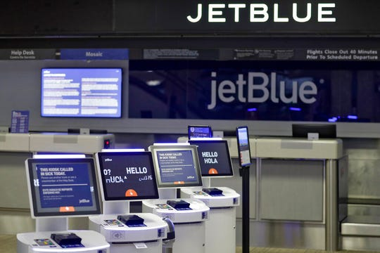 The jetBlue ticket counter at the Tampa International Airport is deserted Friday, May 1, 2020, in Tampa, Fla. JetBlue Airways swung to a $268 million loss in the first quarter.