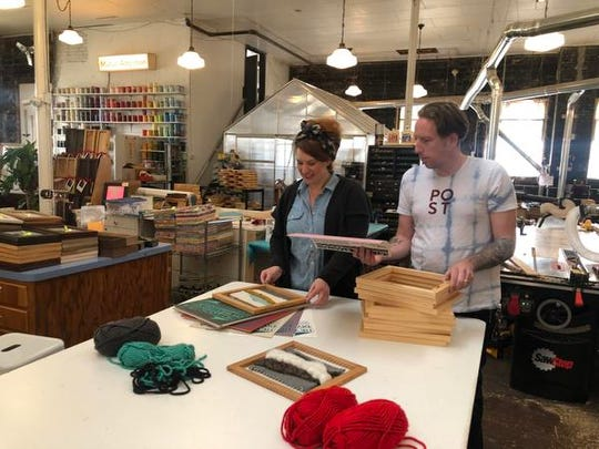 Clare Fox and her husband Wayne Maki, owners of Mutual Adoration, put weaving kits together inside Post that include their handmade looms. The kits are $65 each.