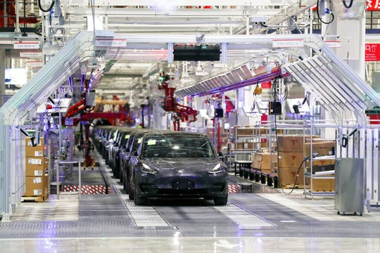 Tesla vehicles are seen on an assembly line at Tesla's gigafactory in Shanghai in this Jan. 7, 2020, file photo. Tesla suspended production at the, according to people familiar with the matter, bringing to a halt all of the company's vehicle manufacturing globally.