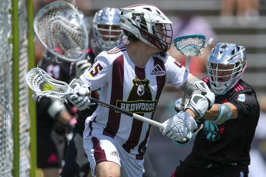 Former Cornell player Clarke Petterson of Redwoods looks to pass against the Chrome in a Premier Lacrosse League game at Homewood Field on June 22, 2019 in Baltimore.