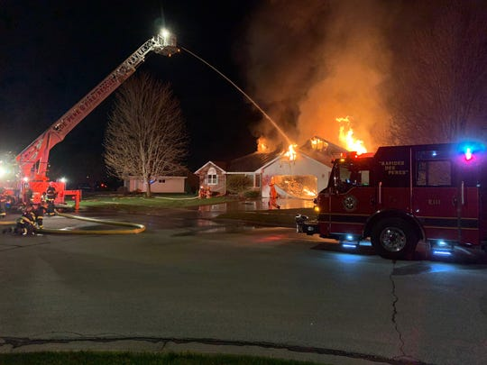 Firefighters battled a house fire Wednesday night in the 1100 block of Jordan Road in De Pere.
