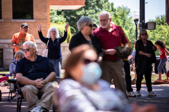 About a hundred people from the community gathered on the Anderson County Courthouse Plaza for the National Day of Prayer Thursday, May 7, 2020