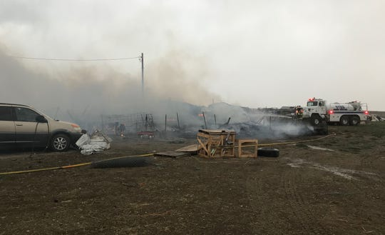 A water tanker from the Vaughn Fire Department is helping to knock down what flames remain from a trailer fire Wednesday afternoon on Wexford Lane south of Sun Prairie Village.