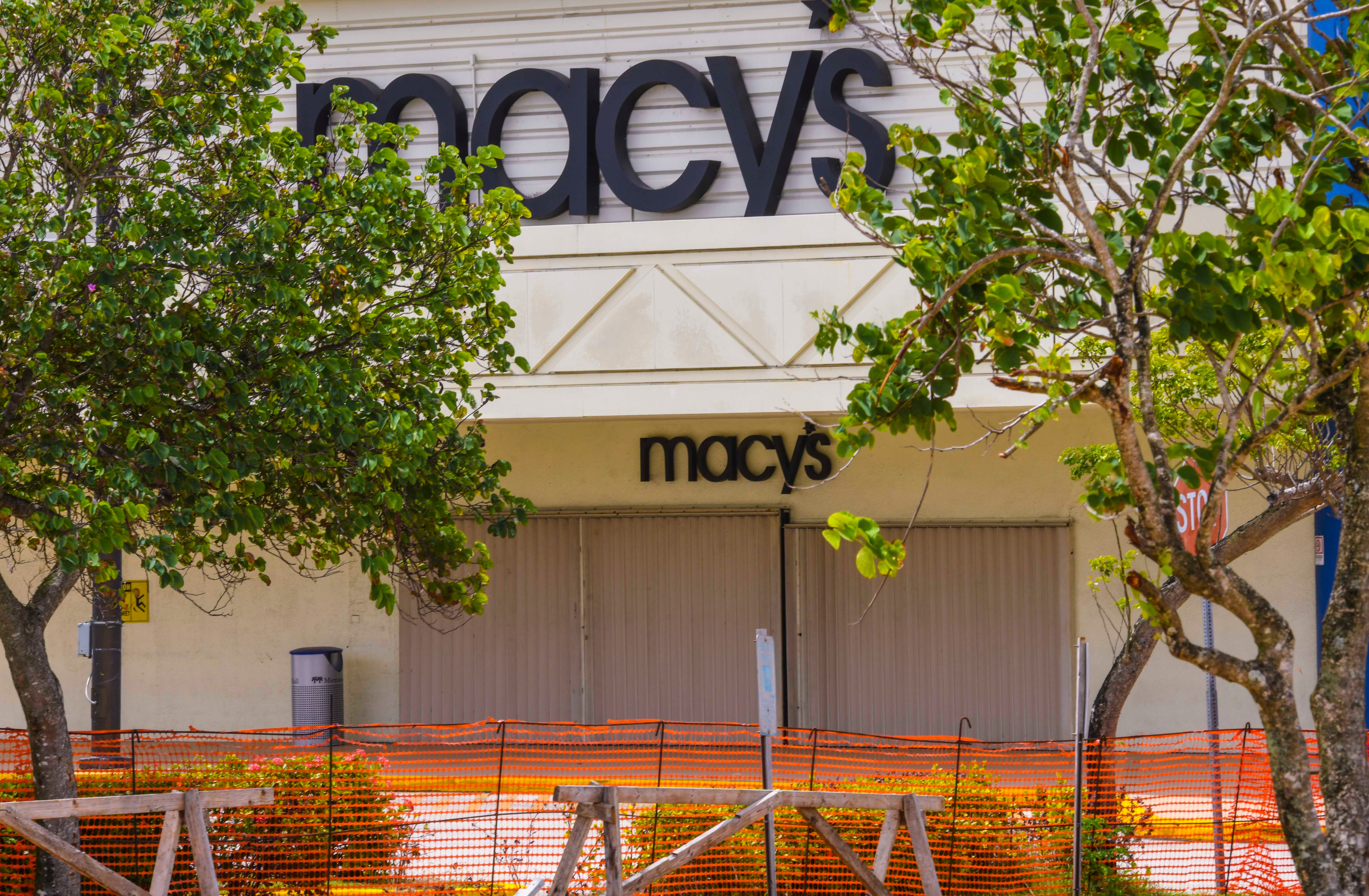 The entrance to the Macy's store remains shuttered as construction work continues in the parking lot of the Micronesia Mall in Dededo on Thursday, May 7, 2020.