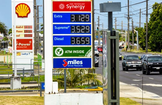 A sign in front of a Mobil refueling station in Dededo reflects an increase of 15 cents, of most gas prices, in comparison to that of a competing Shell station nearby on Thursday, May 7, 2020.
