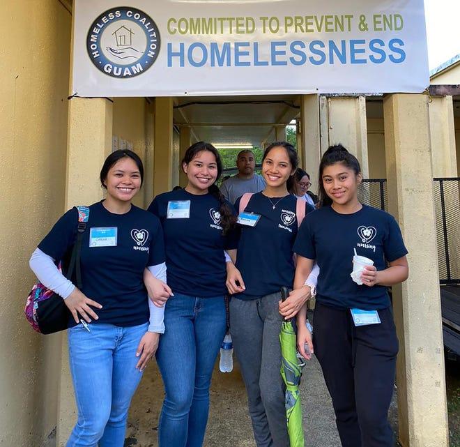 University of Guam nursing seniors Cirena San Nicolas, Aubrey Pablo, Marissa Aguon, and Rea Dimag assist at a Guam Homeless Coalition event.