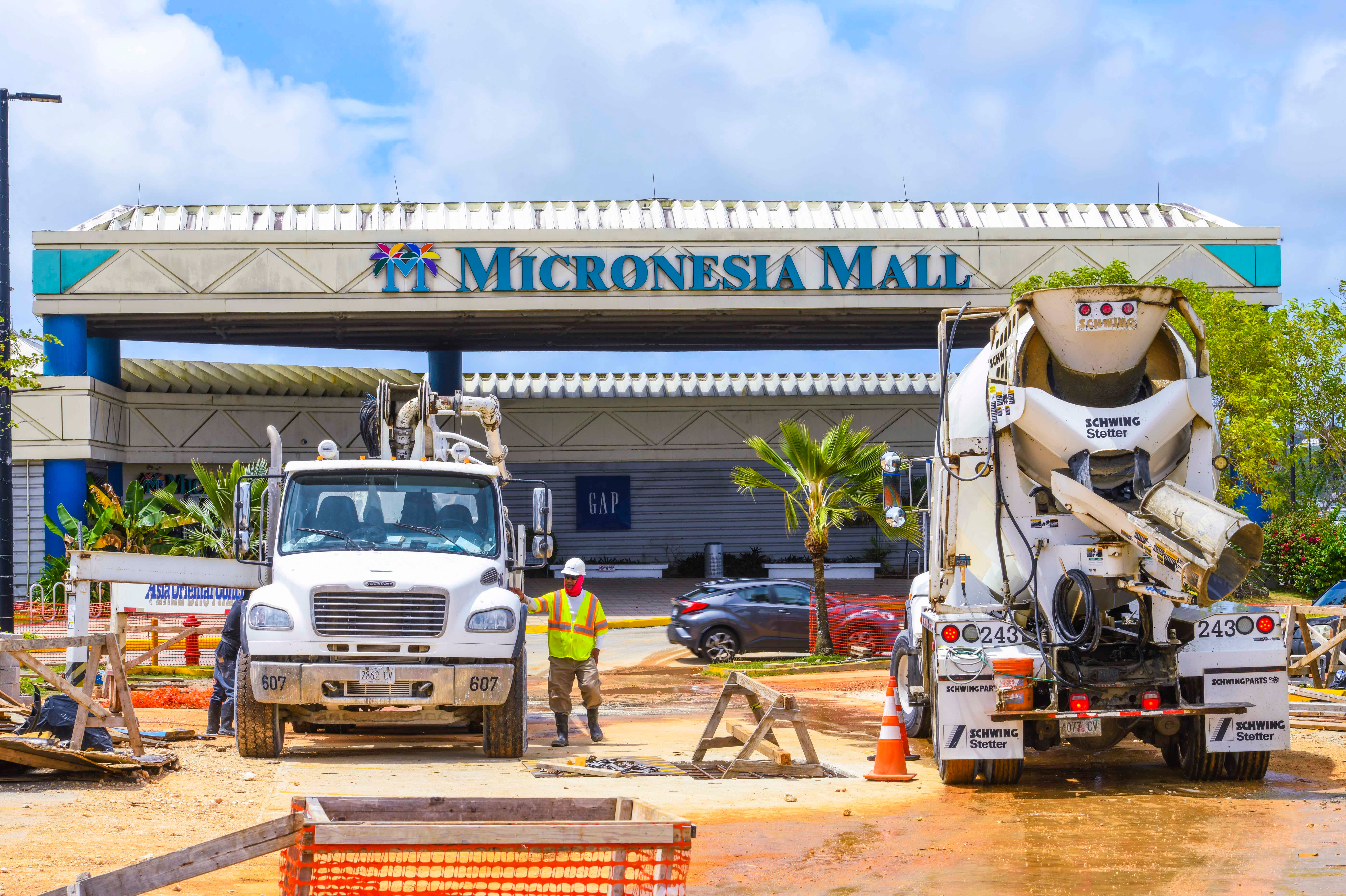 Construction work in the parking lot of the Micronesia Mall in Dededo on Thursday, May 7, 2020. Shopping centers, real estate offices, automotive sales and salons are among the select businesses allowed to reopen May 11.