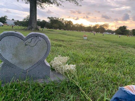 DeAndria Turner, 22, of Gautier, Miss., visits her mother's gravesite.