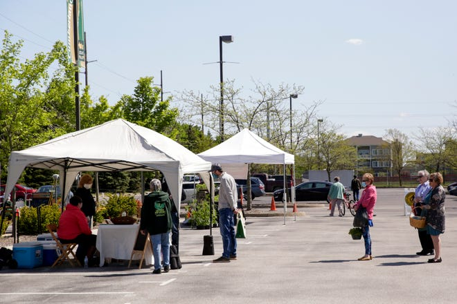 The West Lafayette Farmers Market opened for the first time in 2020 with new regulations amid the coronavirus pandemic, Wednesday, May 6, 2020 in West Lafayette.