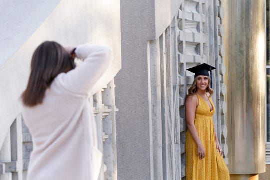 Emma DeHart poses for photos at the Engineering Fountain, Wednesday, May 6, 2020 at Purdue University in West Lafayette.