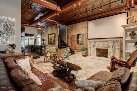 Castle-like home in New Iberia has hidden doors, infinity pool and heated spa. On the market for $750,000, this townhouse has Corinthian columns, stamped copper ceilings and African Mahogany floor to ceiling wall.