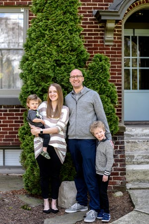 Stephen Purchase, right, his wife Karissa Chabot-Purchase and their two sons photographed on Thursday, May 7, 2020, at their Lansing home. Stephen was among the first in Lansing and overall Ingham County to be diagnosed with COVID-19.