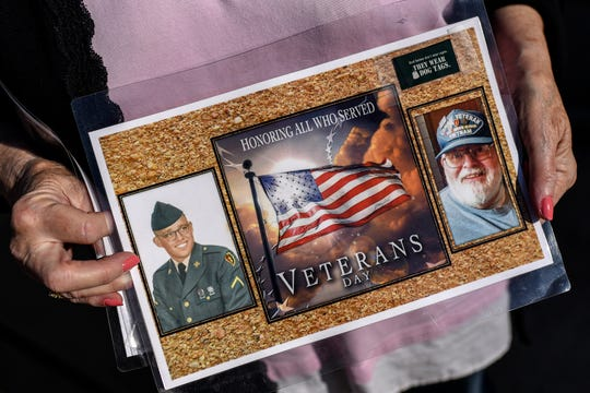 Barbara Kowalk holds a Veterans Day collage of her late husband Arthur on Wednesday, May 6, 2020, in Lansing. Arthur, a Vietnam veteran and classic car enthusiast, died on April 13. He had been hospitalized with other health issues, but shortly before his death was diagnosed with COVID-19.