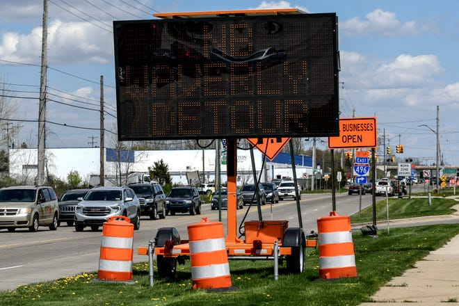 A sign alerts drivers of upcoming construction on Waverly Road near the I-496 overpass on Thursday, May 7, 2020, in Lansing.