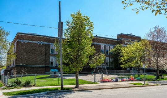 The Wilson Center in St. Johns, which takes up an entire city block, is up for sale. The St. Johns Board of Education may decide what to do with it soon.