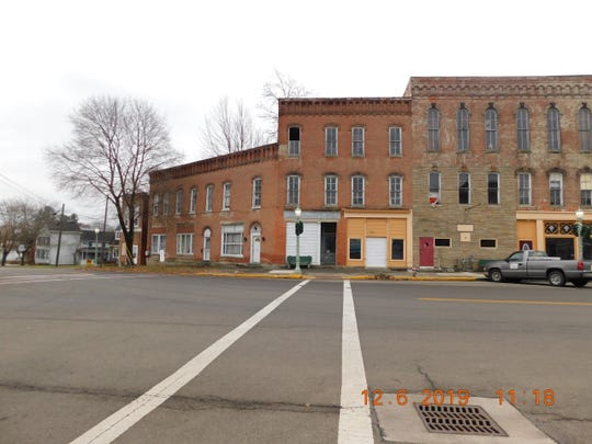 The Richland County Land Bank is considering whether to take ownership of the former Plymouth Hotel.