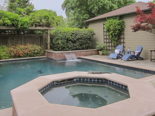 The backyard was landscaped by the previous owners and the work included adding a pool.