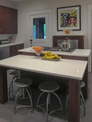 The McGoffs' kitchen includes an oversized island that combines a stove top with a casual eating area.